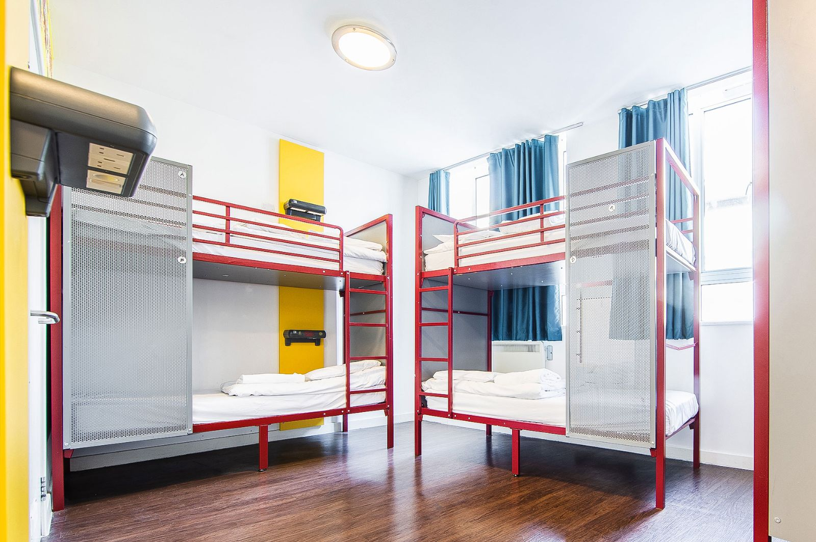 Three Crables in a dormitory with bunkbeds